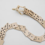 social media (image: figurine pushing string of dominos down)