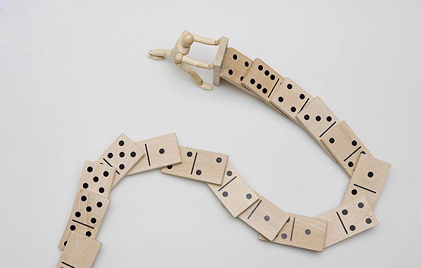 social media (image: figurine pushing string of dominos down)