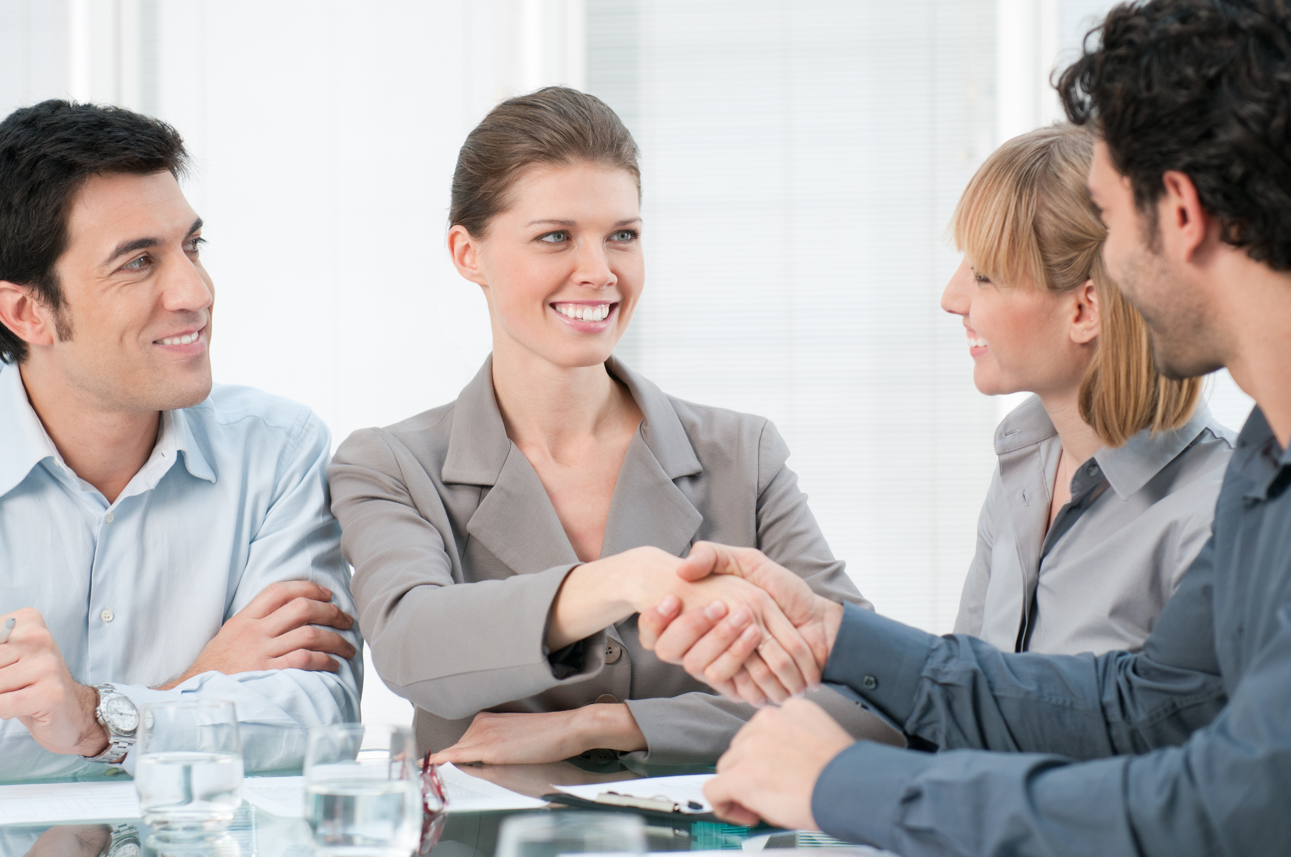 Referral marketing (Image: Happy smiling businesswoman shaking hands after a business meeting)