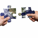 Channel Marketing (image: hands holding pieces of jigsaw puzzle)